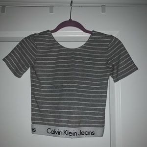 Grey and white striped crop top with low back